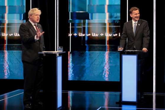 Boris Johnson and Jeremy Hunt during the first televised debate on ITV.