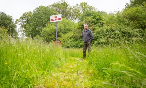 "Councillor Forbes says unkempt greenspaces are making residents' lives "" a misery""."
