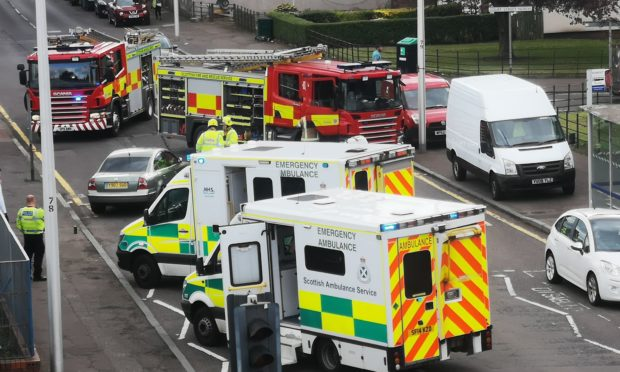 Fire and ambulance services at the scene.