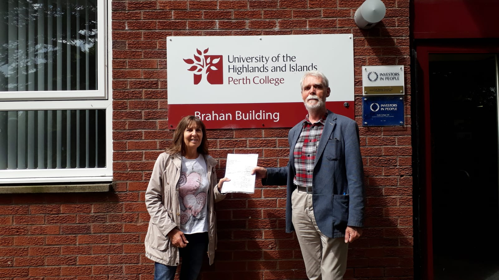 Elspeth McCole and Pete McCara hand over petition to save Crieff learning centre