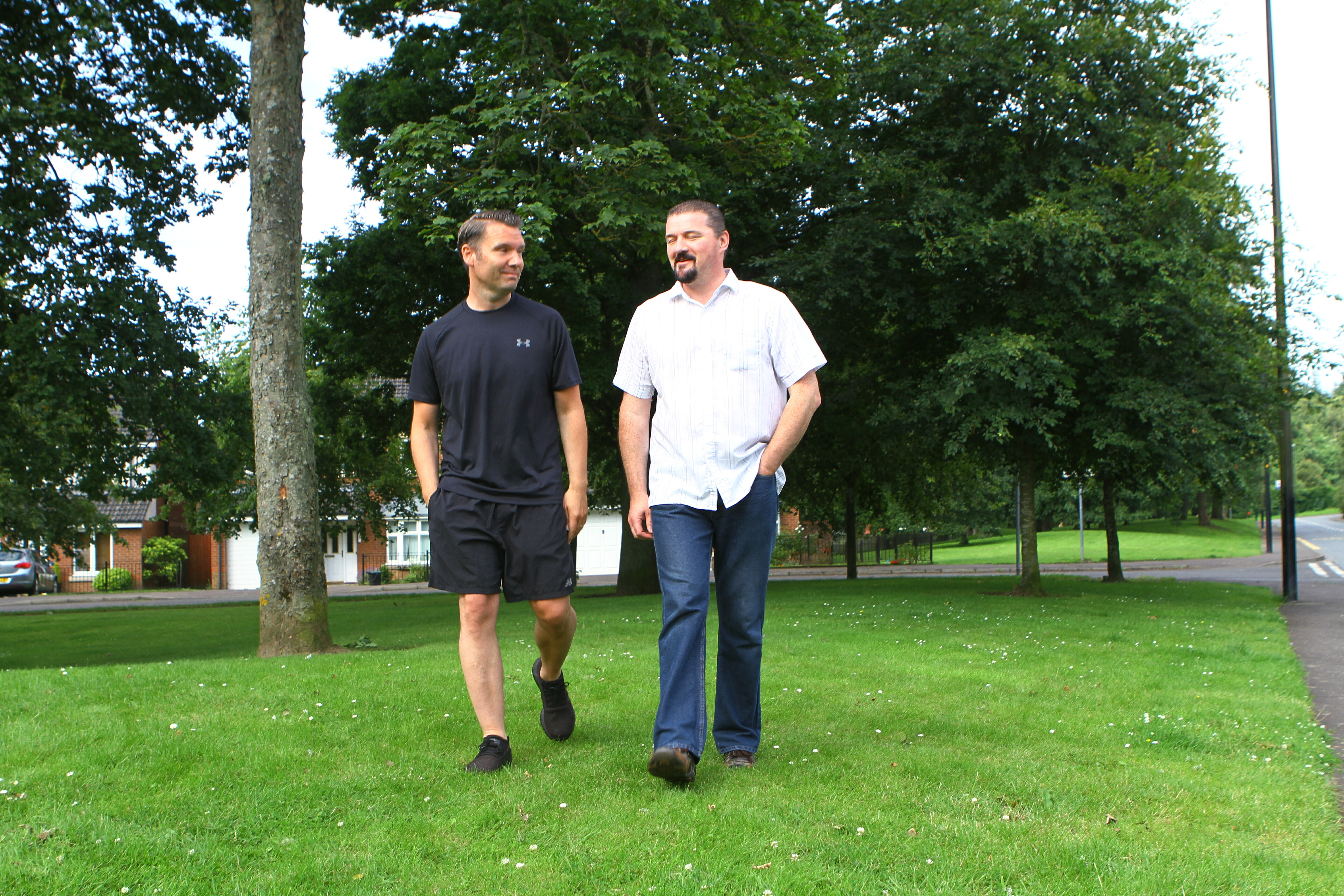 John Walsh, left, and his neighbour Philip Harrison claimed they didn't know about annual grass cutting fees