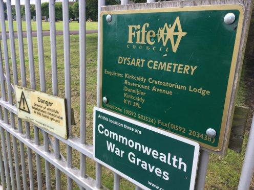 Police are investigating   thefts from a Fife graveside.