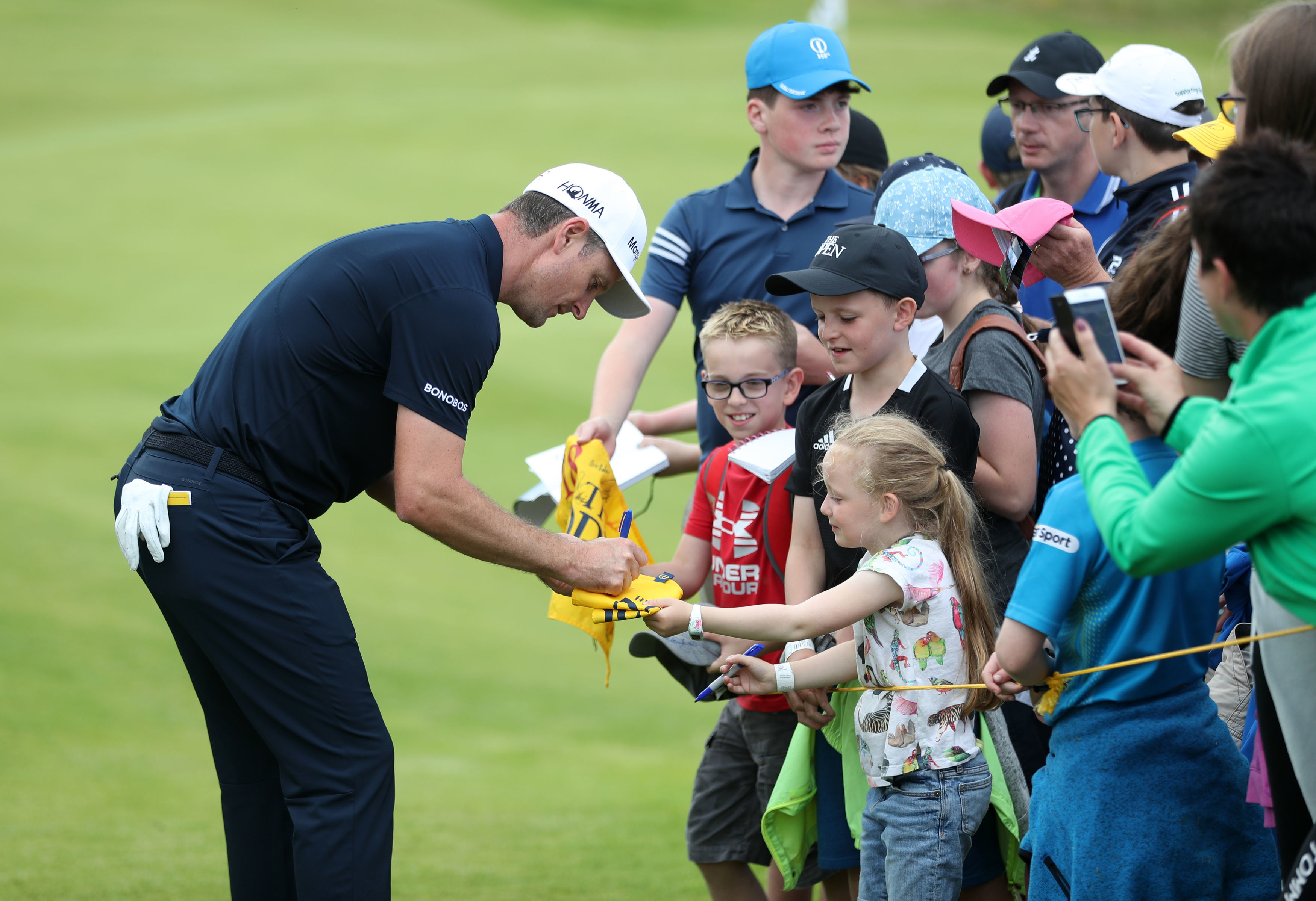 Justin Rose meets the locals at Portrush.