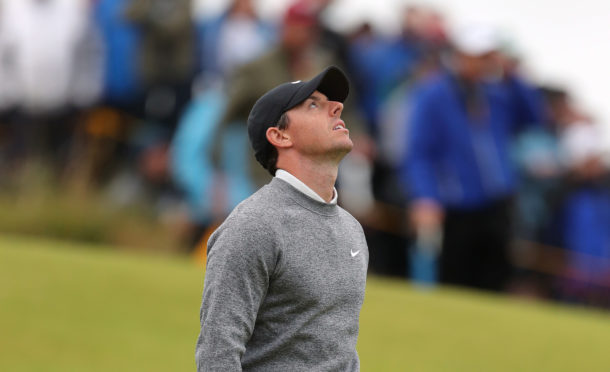 Rory McIlroy reacts emotionally to a missed putt during his final round comeback.
