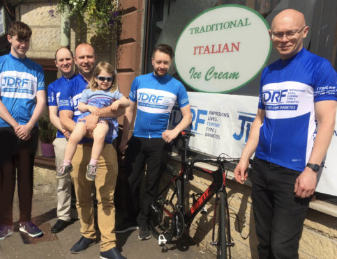 Getting on their bikes for a good cause are, from left, Morgan Traynor, Sean Colebourn, Franck (pictured with Anita); Nathan Owen and Milnathort shop manager Gregor Mcclung.