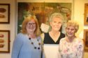 Artist Pam Kelly with painting of 79 year old ex-weaver Lily Thomson