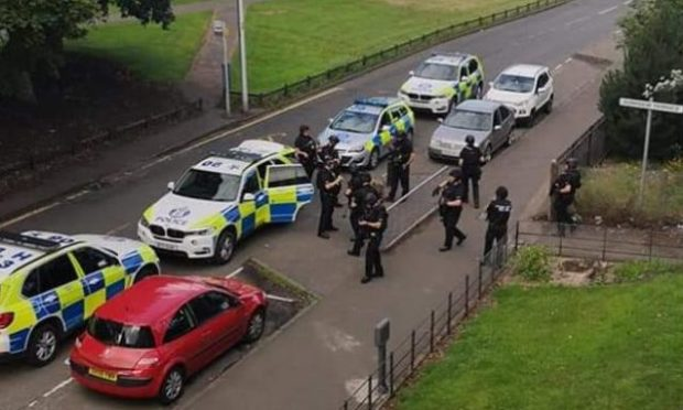 Armed police in the Charleston area of Dundee