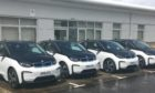 Weeds are growing around the little-used fleet of council BMW EVs.