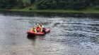 A water rescue team for the Scottish Fire and Rescue Service paddles on the River Tay near Stanley.