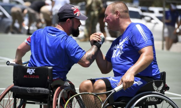 John (left) won gold with American Staff Sgt. Brian Biviano.