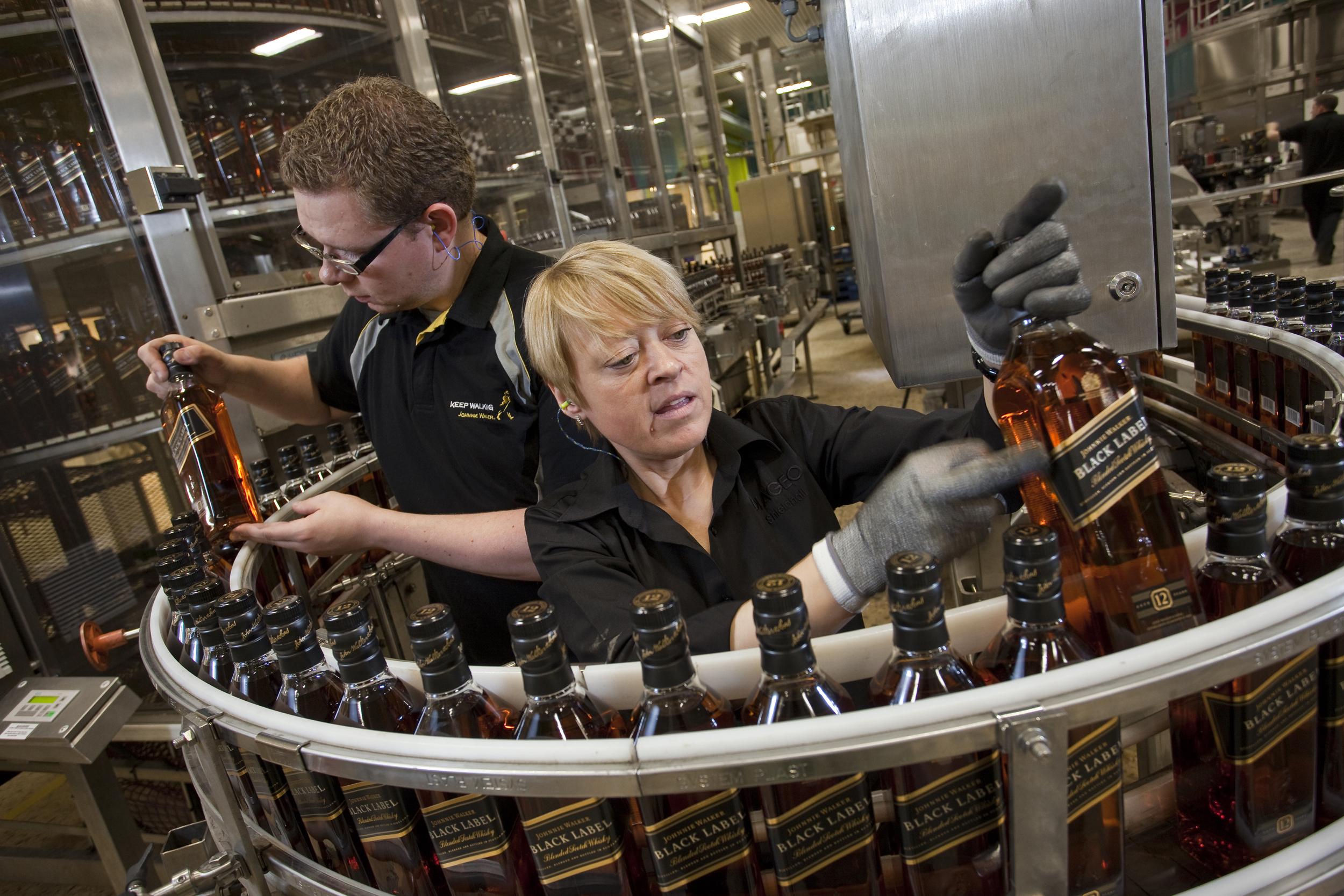 Workers on the Johnnie Walker Black Label bottling line.