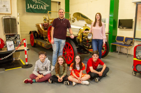 Principal actors in the forthcoming production pose alongside a replica car at Dundee Museum of Transport as they await their own five-figure prop's arrival.