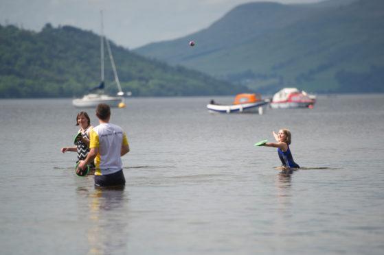 A family enjoys the July 2019 heat at Killin, Loch Tay.