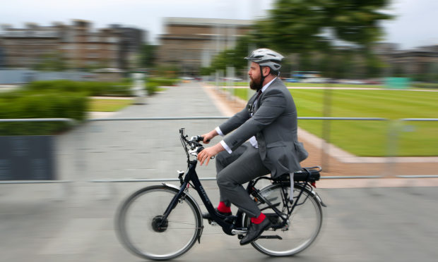 The scheme may see more suit-clad commuters travel by bike in the city