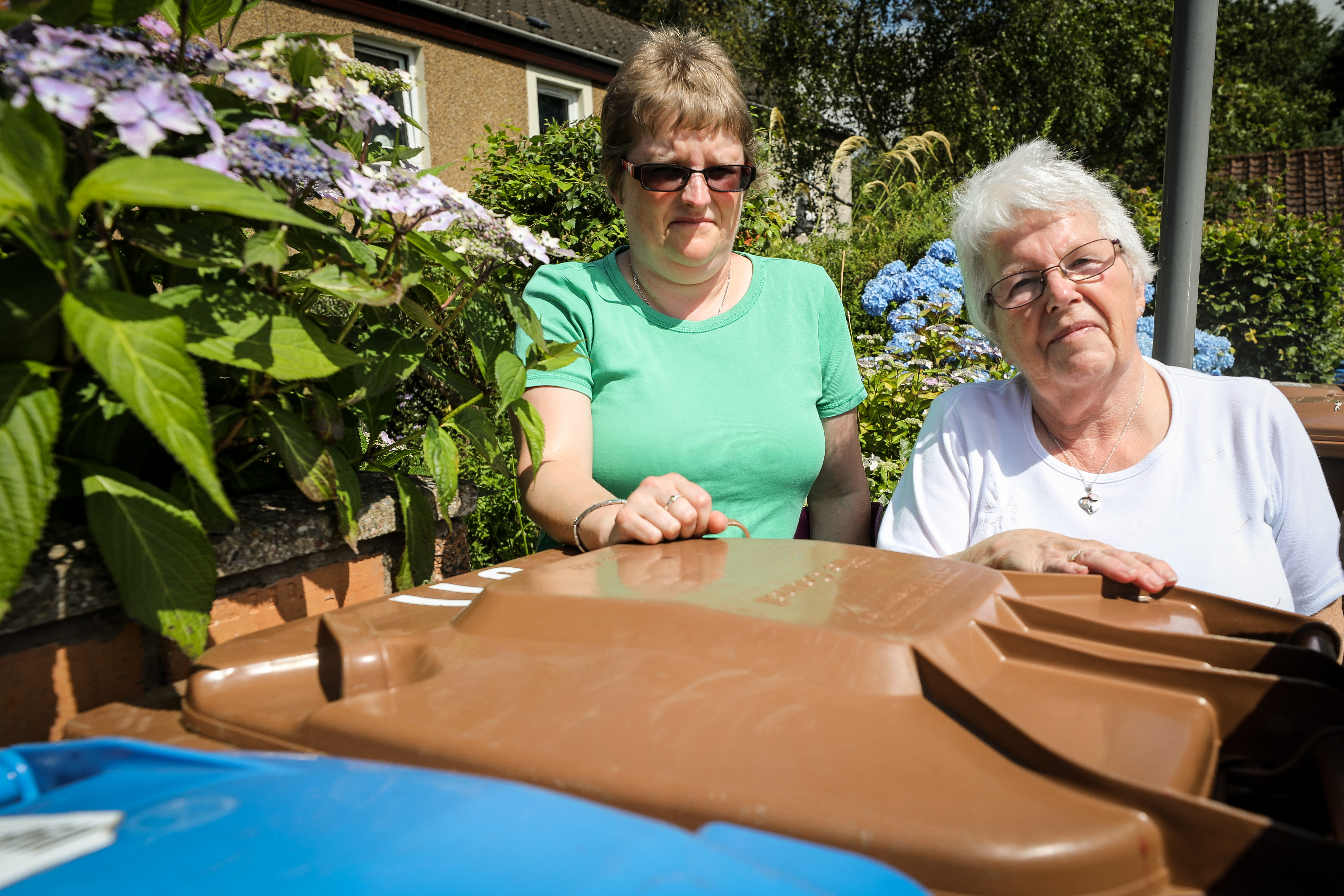 Denise and Mary Wallace beside bins in Rona Place, Glenrothes.