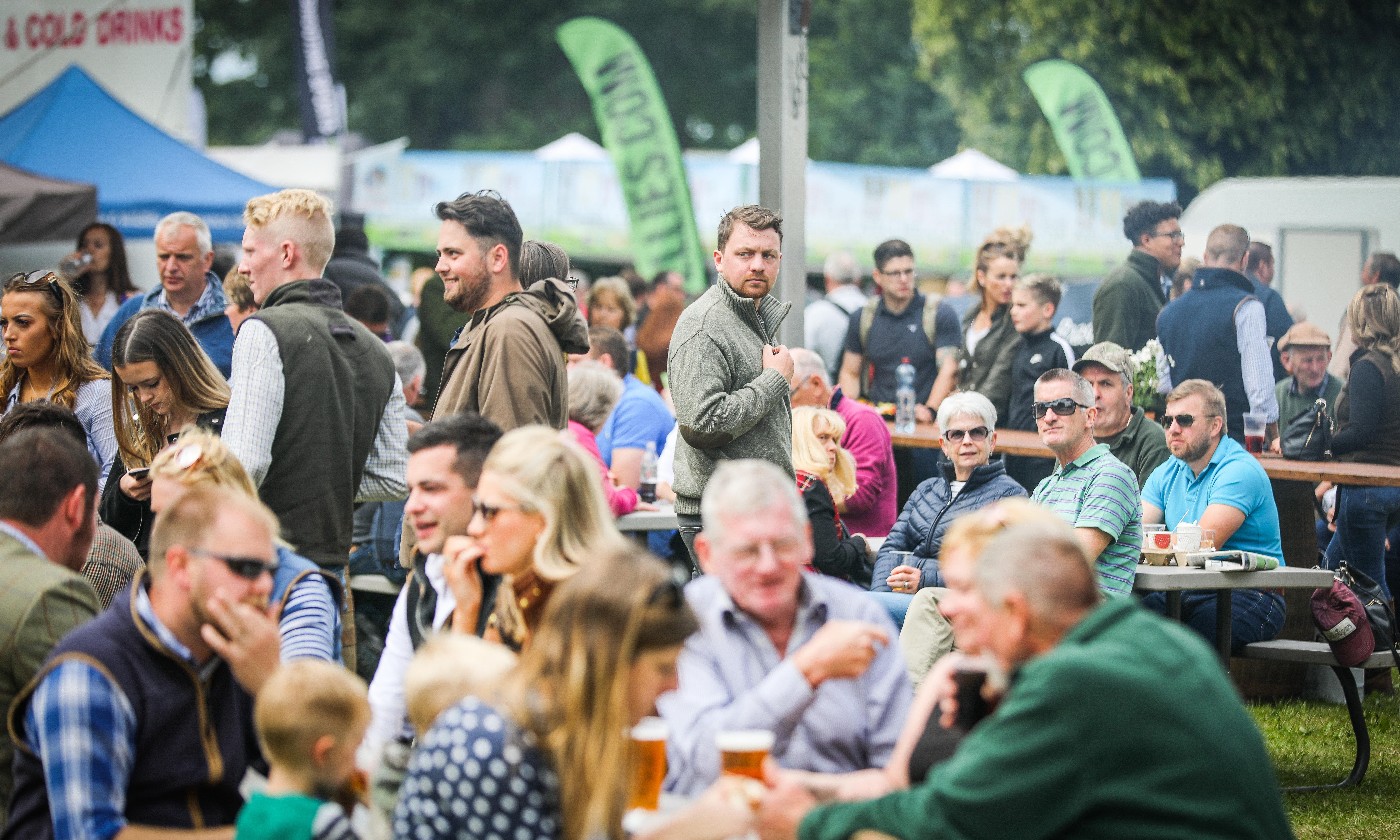 Crowds enjoying refreshments at the Scottish Game Fair at Scone Palace.