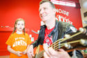 Simple Minds bassist Ged Grimes rehearsing with children taking part in the Big Noise Douglas holiday club