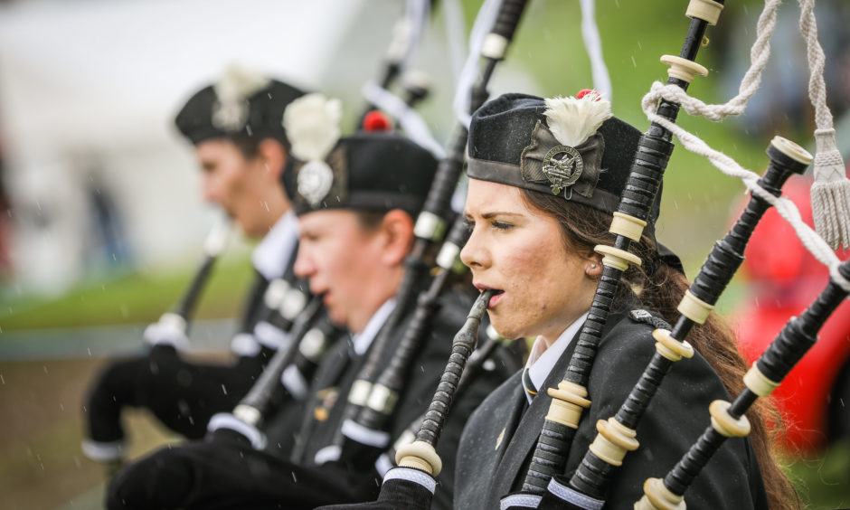 The pipe band performing.