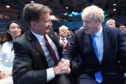 Jeremy Hunt (left) congratulates Boris Johnson at the Queen Elizabeth II Centre in London where he was announced as the new Conservative party leader.