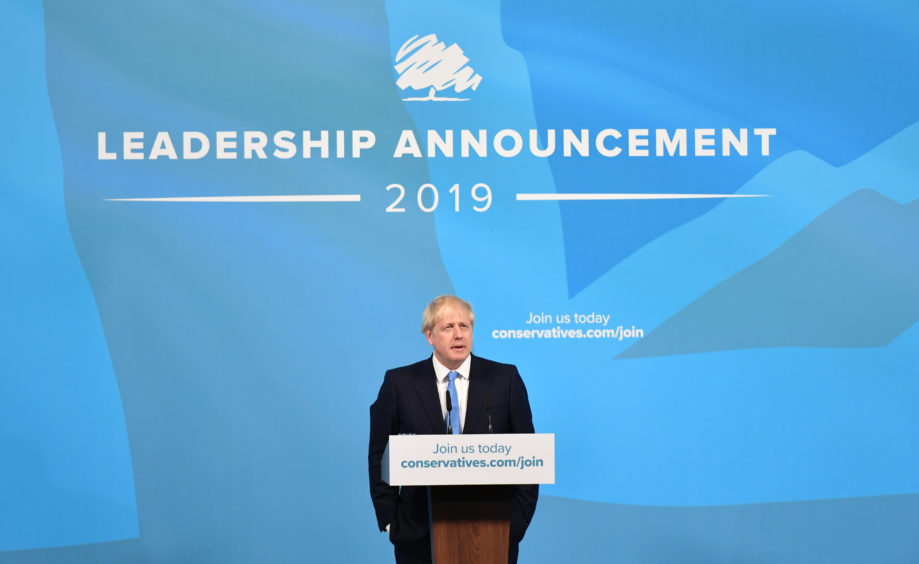 Boris Johnson speaks at the Queen Elizabeth II Centre in London after being announced as the new Conservative party leader and his transition to become the next Prime Minister.