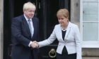 Scotland's First Minister Nicola Sturgeon welcomes Prime Minister Boris Johnson to Edinburgh in July 2019.
