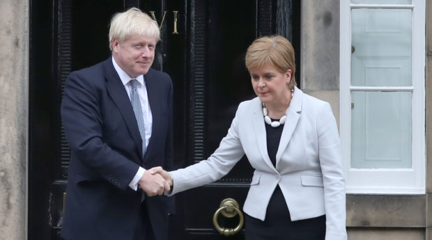 Scotland's First Minister Nicola Sturgeon welcomes Prime Minister Boris Johnson to Edinburgh in July 2019.