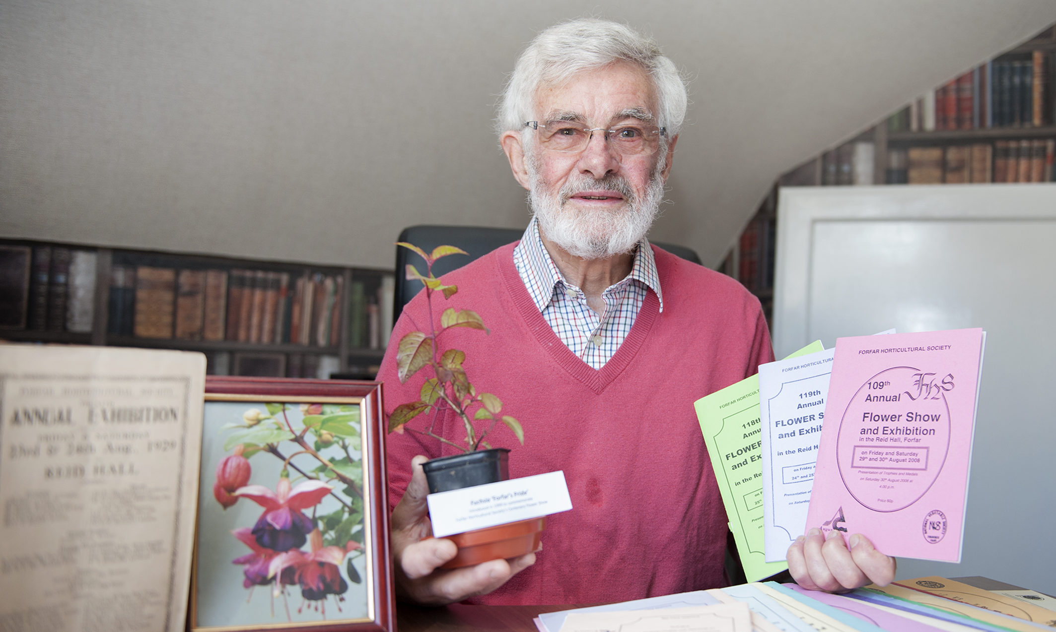 Forfar Horticultural Society chairman Jim Ewing with previous show memorabilia.