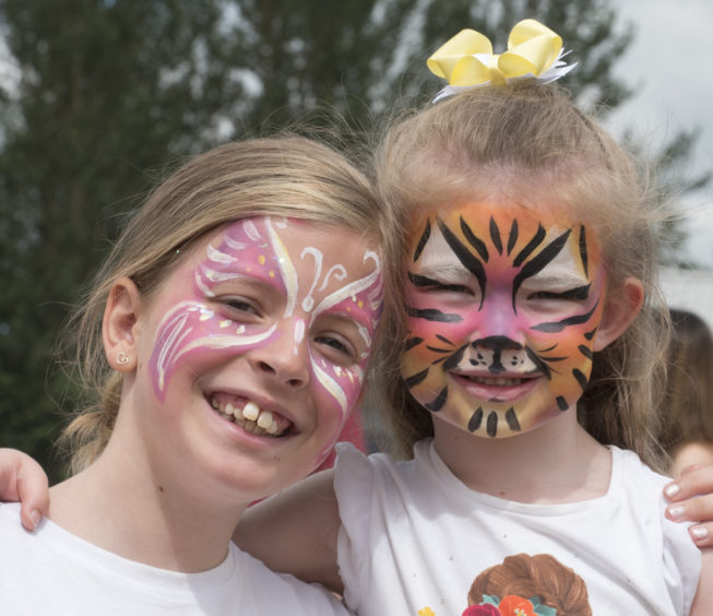Face painting fun for cousins Zoe and Eva Russell.