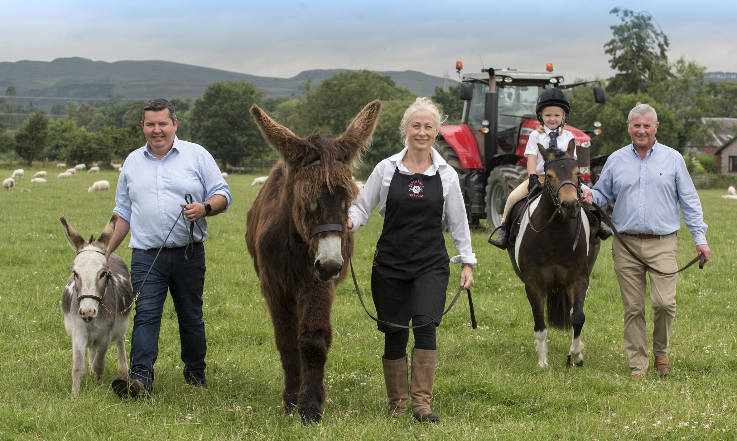 Chairman Donald McDiarmid with donkey Goose and secretary Neil Forbes, Lottie Pitcaithly (4) with her pony Dolly and Vicki Unite with giant infant donkey Hettie.