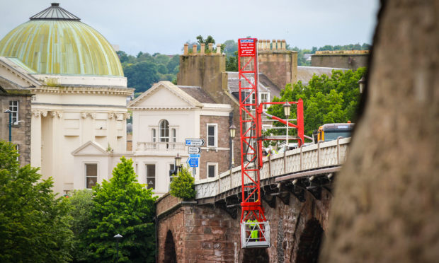 Work is under way on new lighting at the historic Perth Bridge