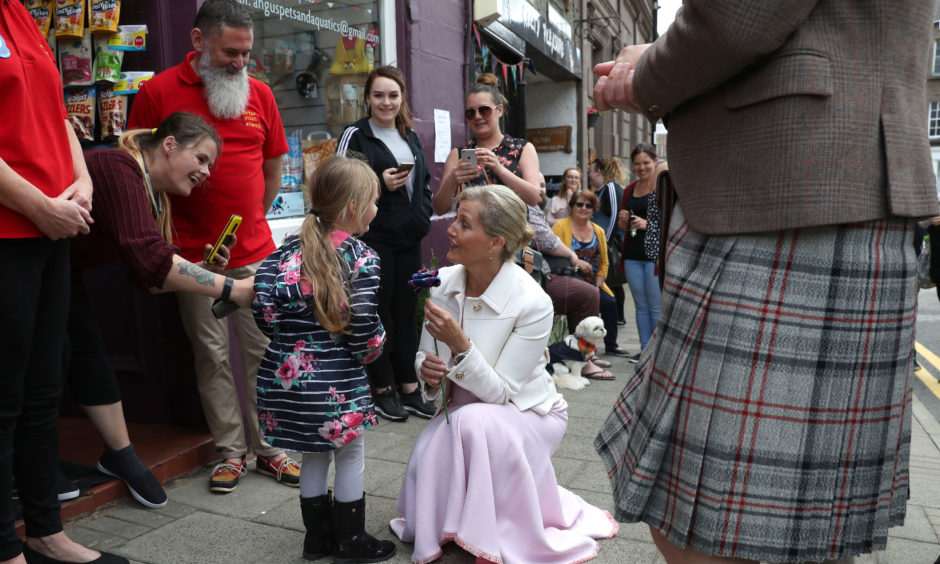 The Countess of Forfar chats to Penny Anderson during a walkabout in Forfar.  Penny gave the Countess a hug and gave her a flower.
