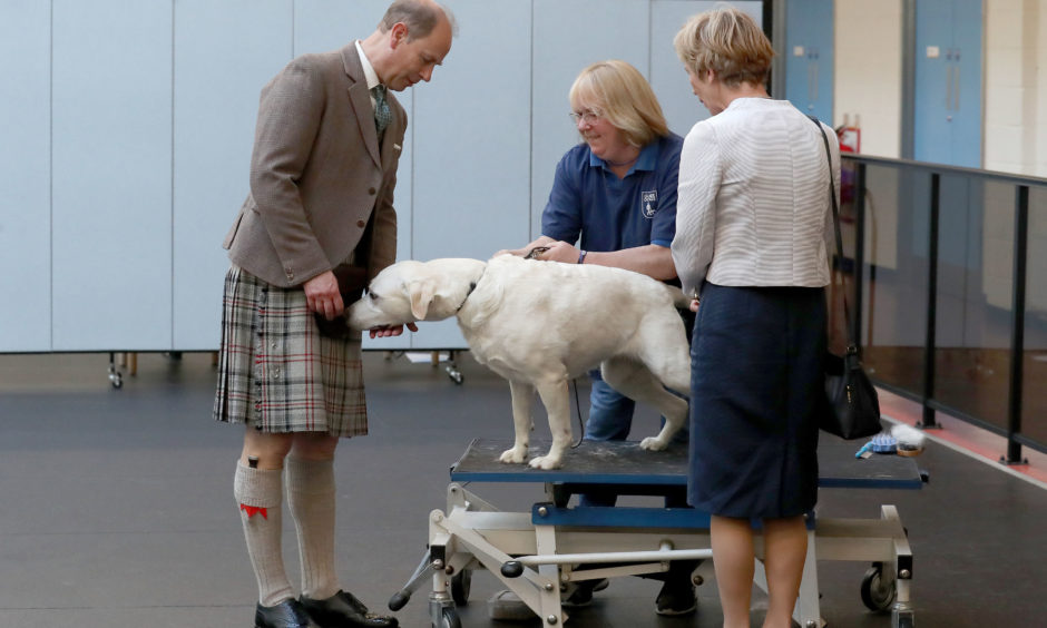 The Earl of Forfar during a visit to the  Guide Dogs training centre in Forfar.