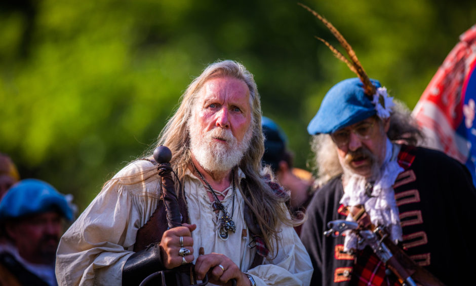 Scenes from the ceremony at the battlefield memorial cairn commemorating the 330th anniversary of the Battle of Killiecrankie.