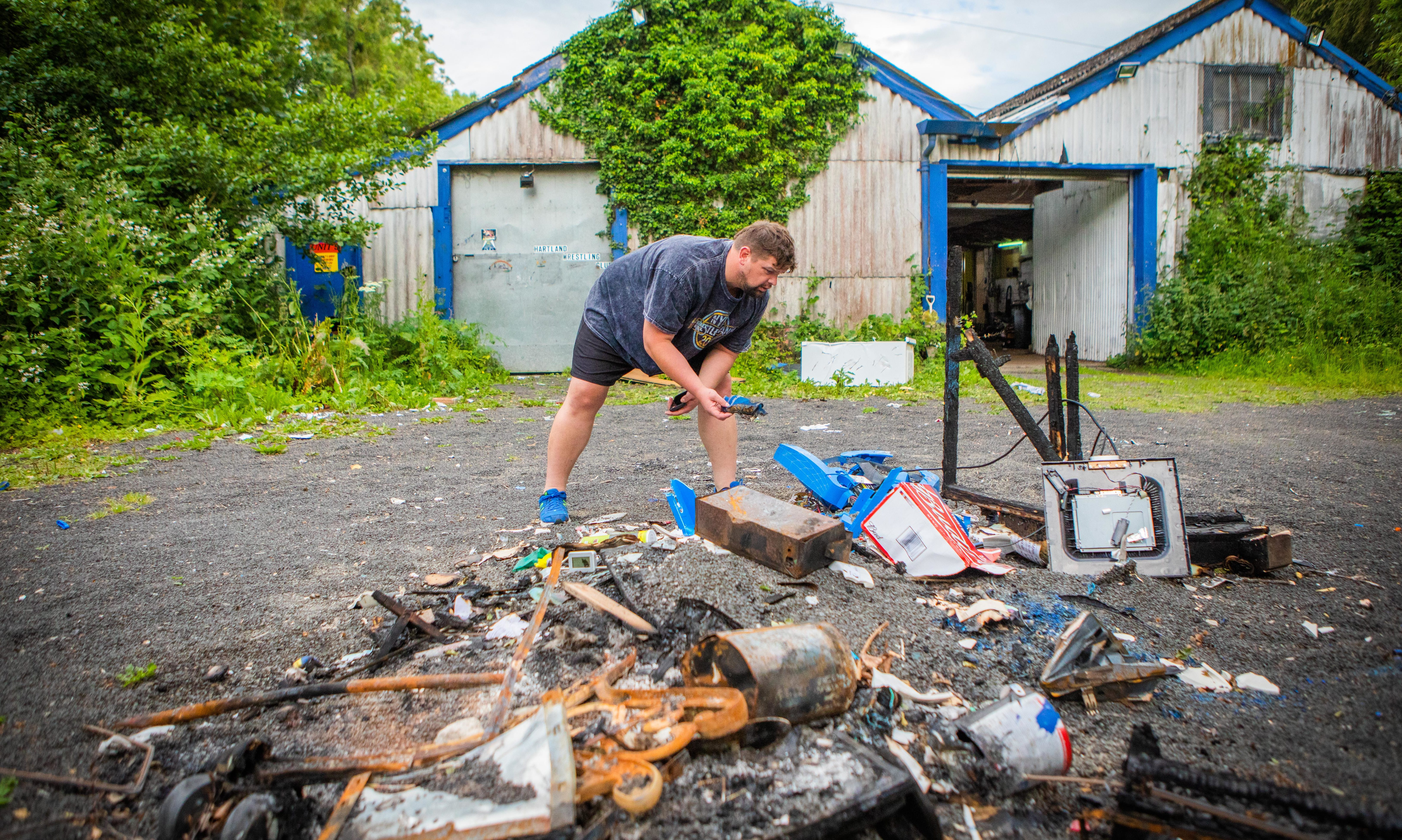 David Low looks through the damage and burned objects. Hartland Wrestling Club, Welton Road, Blairgowrie.
