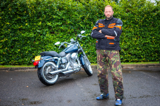 ames Begg and his motorcycle.