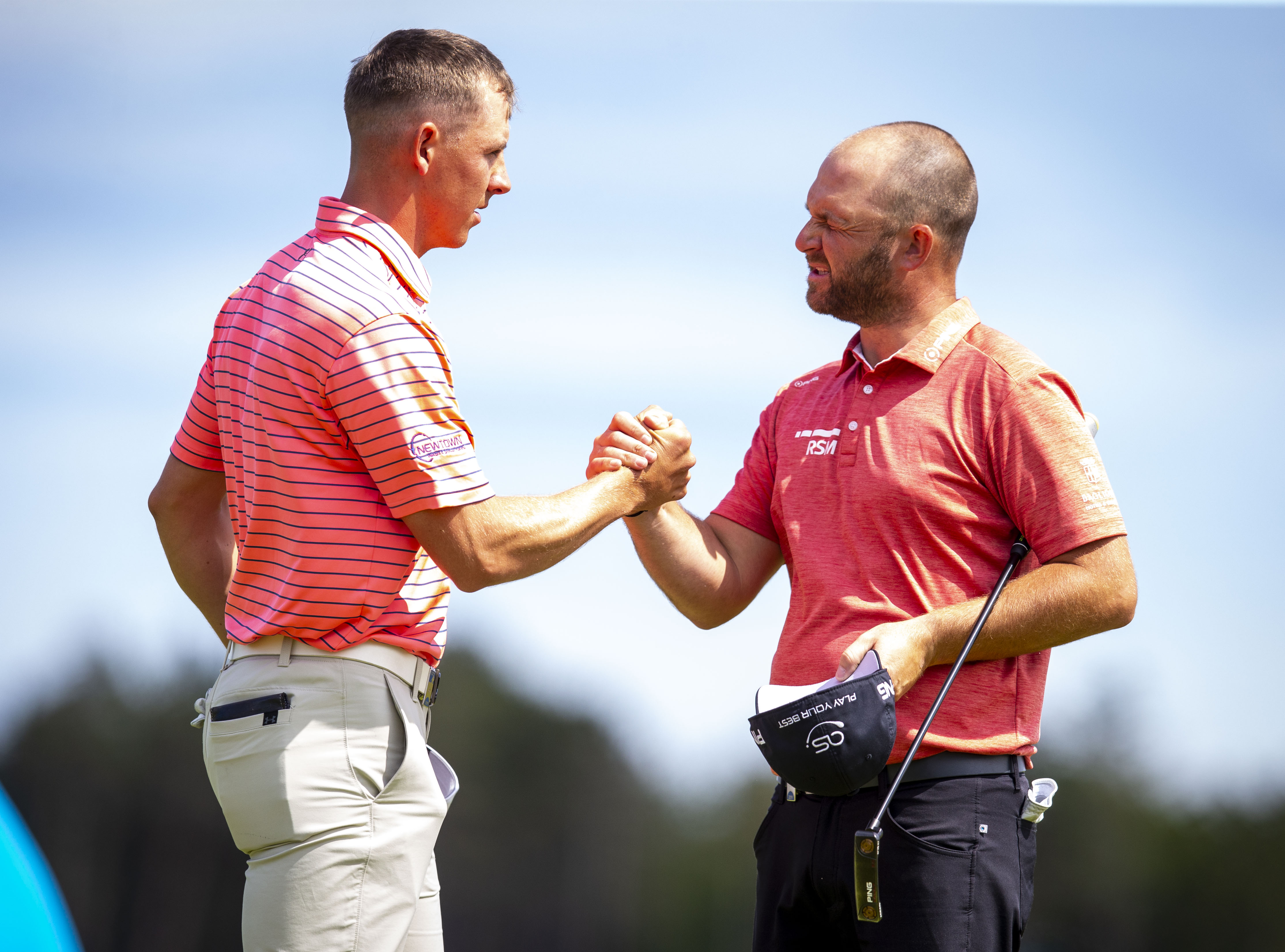 Scotland's Grant Forrest and Andy Sullivan shake hands after their round in the Scottish Open.