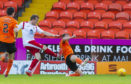 Liam Watt scores against United.