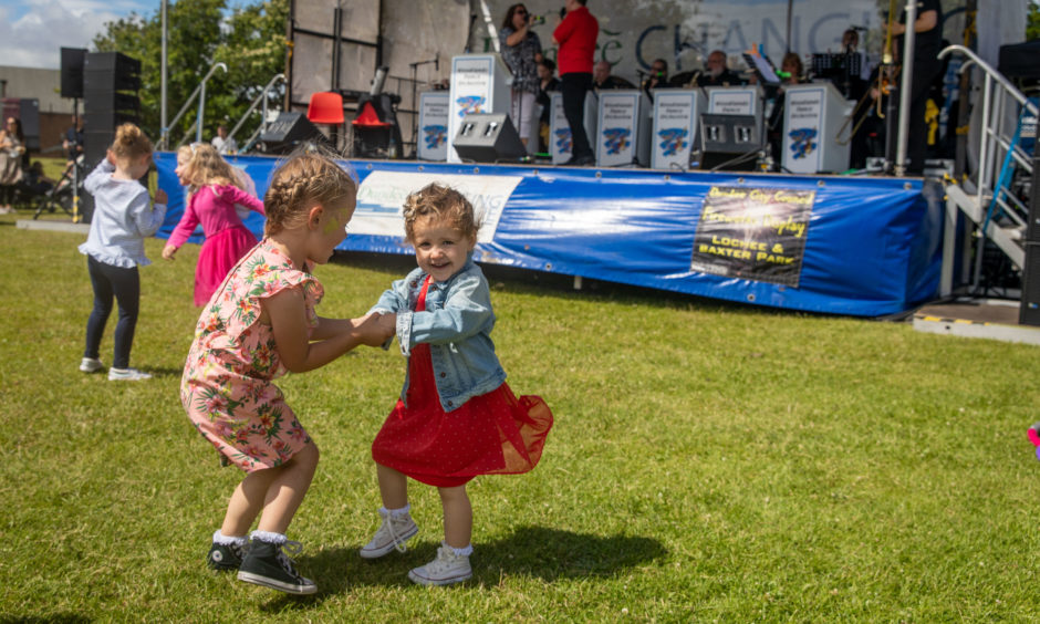 Elena (2) and Molly Sangster (5) from Kellas dancing to the band.