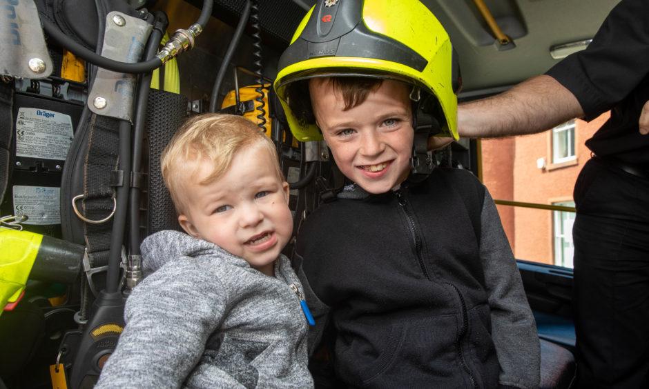 Arthur Hayburn (2) and Kruz Buchan (8) in the fire engine.