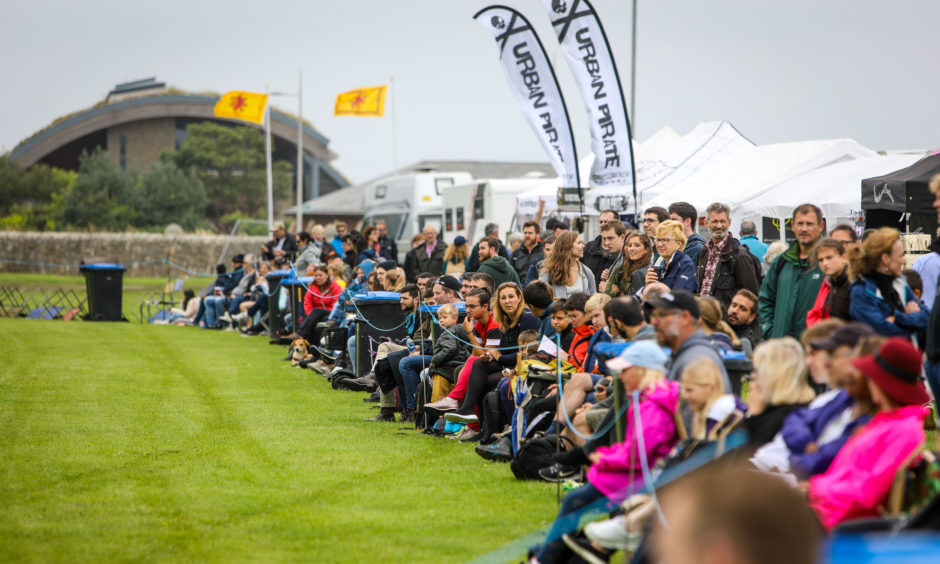 Crowds line the track waiting on the official opening of The St Andrews Highland Games. All pictures by Steve Brown / DCT Media