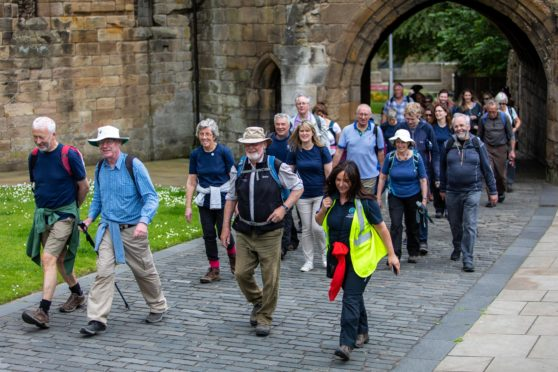 Walkers make their way on a special 8.5-mile section of the Pilgrim Way as part of the official opening day. Some donned costumes to mark to occasion.
