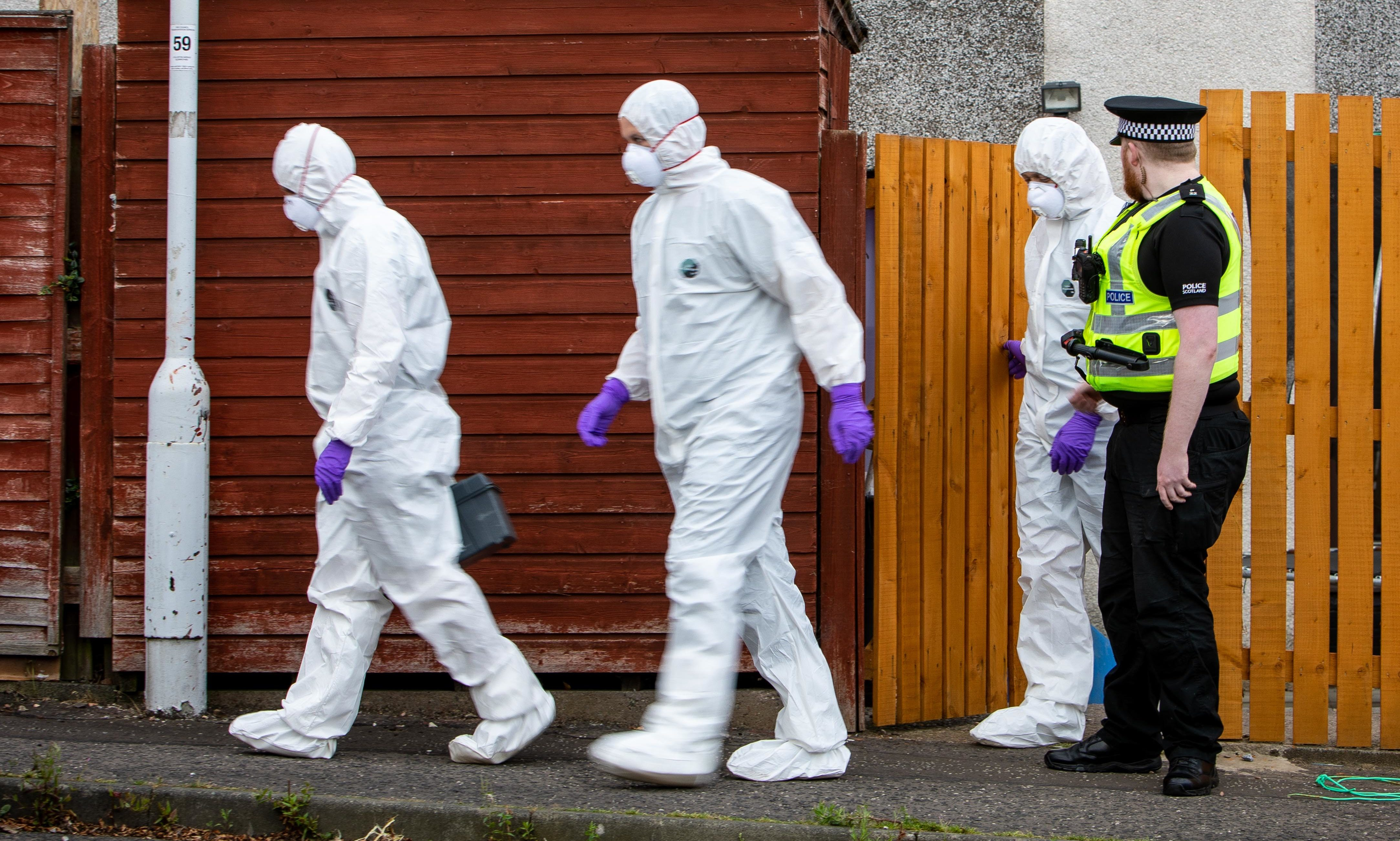 Forensic officers at the house in Glenrothes.