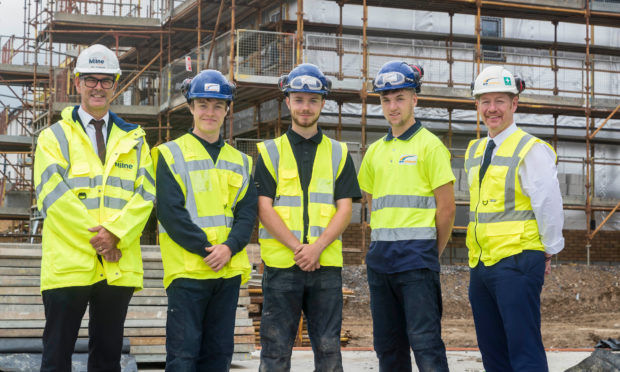 Stewart Milne Construction director Neil Thomson (left)  with workers from Stewart Milne Homes North
