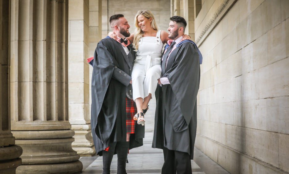 Craig Fraser, 22, from Alness graduates in Game Design and Production with girlfriend Lucie McGonigle, and Adam FitzGerald, 23, graduating in Game Design Production Management from Devon.