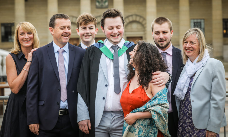 Matt Hunter, 24, from Gloucester graduates in Computer Games Technology with all his family and girlfriend Hayley McCullough.