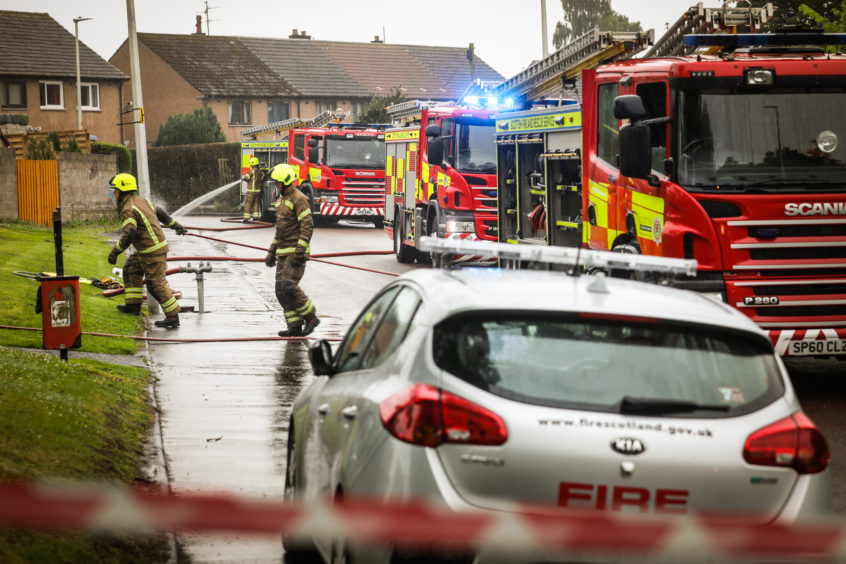 Fie crews on the scene of a fire at the Red Chilli takeaway in Fintry, Dundee