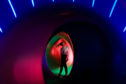 People wander through the domes of the luminarium.