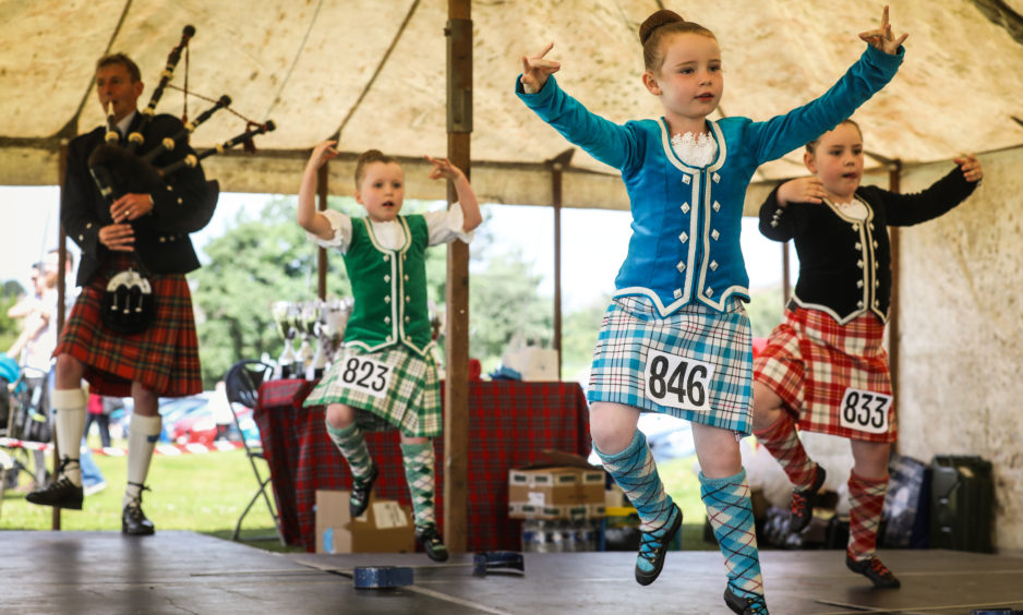 Girls compete in the beginners Highland Sword Dance.