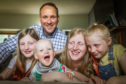 Tom Simmonds with Gracie, 10, Poppy, 16 months, Danielle and Holly, 7.