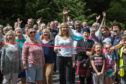 Members of the Auchterarder Core Paths Working Group and Grace Martin of Sustrans Scotland cut the ribbon